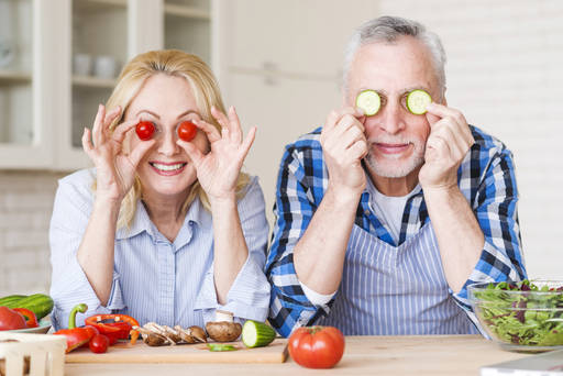 smiling-senior-couple-holding-cherry-tomatoes-and-cucumber-slices-in-front-of-their-eyes.jpg